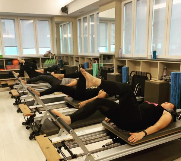 Reformer Pilates group workout by Stacey J